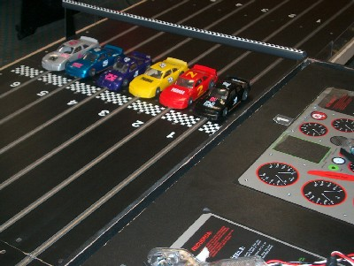 circuit 24 slot racing soir e racing formule 1 scalextric voitures electriques teambuilding. Black Bedroom Furniture Sets. Home Design Ideas
